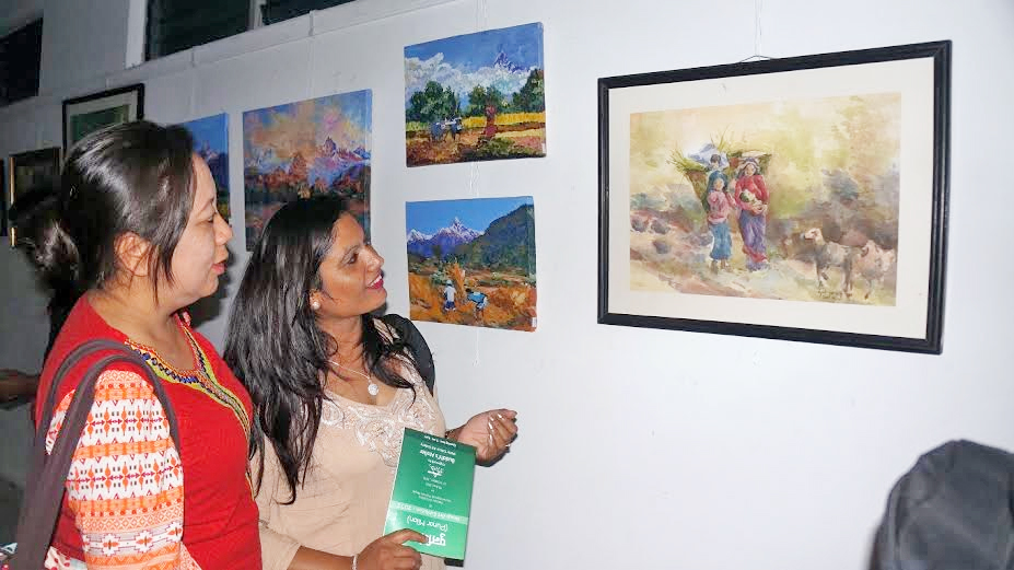 People observing an art exhibition held in Pokhara Art Gallery at Mahendrapul of Pokhara in Kaski district, on Friday, October 09, 2015. Photo: Bharat Koirala