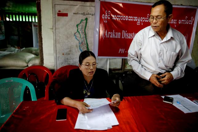 Aye Nu Sein (L), vice president of Arakan National Party (ANP), speaks during an interview with Reuters at her party's head office in Sittwe September 3, 2015. REUTERS/Soe Zeya Tun