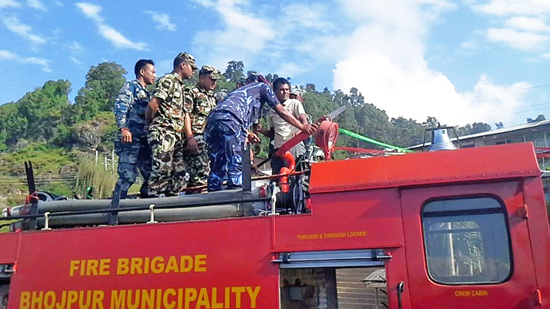 Nepal Army, Armed  Police Force and Nepal Police personnel learn how to operate the newly bought fire brigade in Bhojpur Muncipality of Bhojpur district on Wednesday, October 14, 2015. Photo: Niroj Koirala