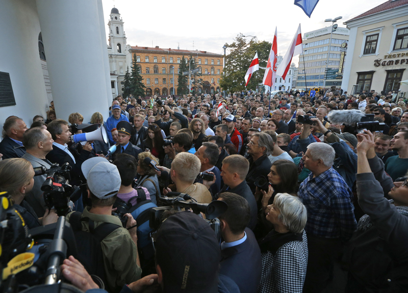 One of the Belarusian opposition leaders Anatoly Lebedko, with megaphone, talks to people about the upcoming presidential elections in downtown Minsk, Belarus, Wednesday, Sept. 23, 2015. Presidential elections in Belarus are scheduled for October 11, 2015. (AP Photo/Sergei Grits)
