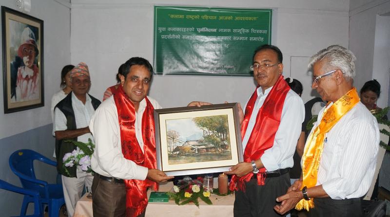 The Himalayan Times Pokhara bureau chief Bharat Koirala is honoured by poet Tirtha Shrestha, in Pokhara, on Monday, October 4, 2015. Photo: THT