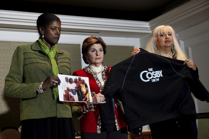 Attorney Gloria Allred (C) stands with two women who have accused actor and comedian Bill Cosby of sexual misconduct as they appear at a news conference in New York, October 23, 2015.  REUTERS/Mike Segar