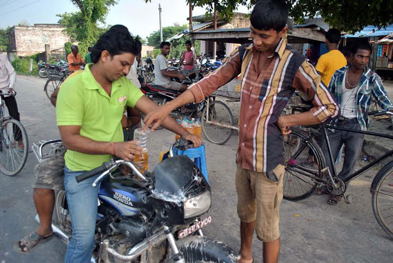 A biker purchasing petrol at Padam Road in Birgunj on Tuesday, October 06, 2015. Photo: Ram Sarraf