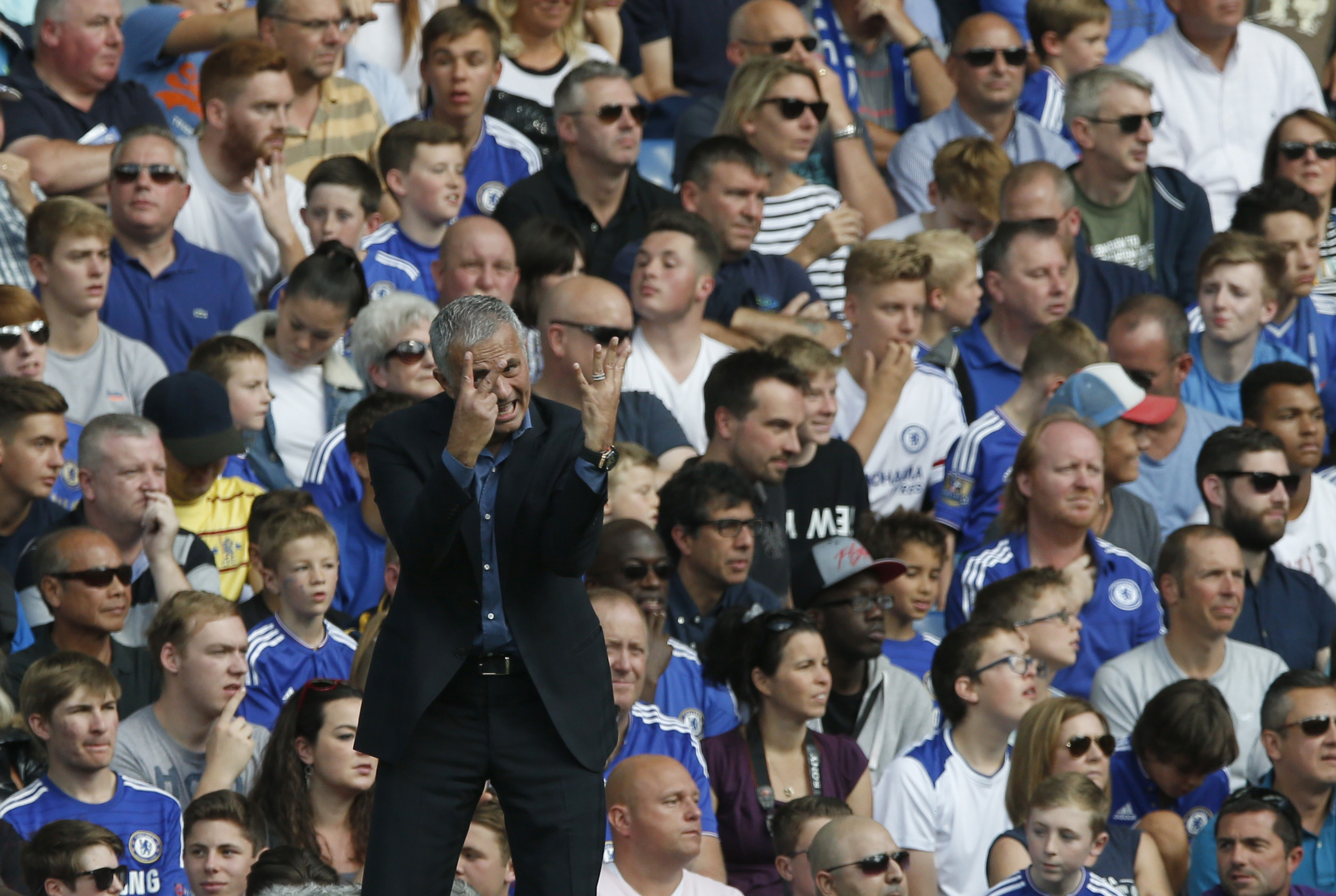 Chelsea manager Jose Mourinho gestures with his hands as he watches his side play during the English Premier League soccer match between Chelsea and Arsenal at Stamford Bridge stadium in London, Saturday, Sept. 19, 2015. Chelsea won the match 2-0.(AP Photo/Alastair Grant)