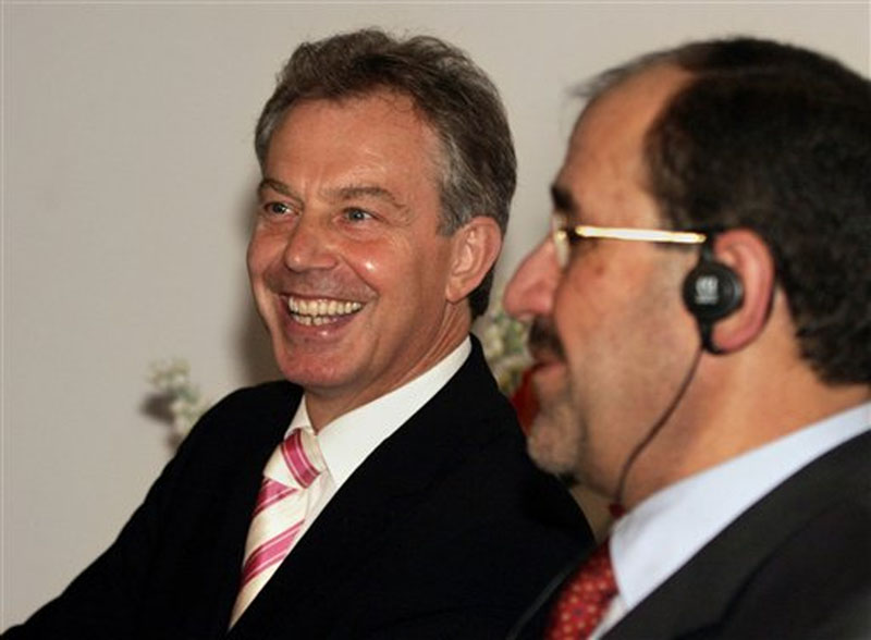 British Prime Minister Tony Blair (left) smiling as he speaks to the media with new Iraqi Prime Minister Nouri al-Maliki at the Iraqi Prime Minister's office in Baghdad, Iraq on Monday, May 22, 2006. Photo: AP