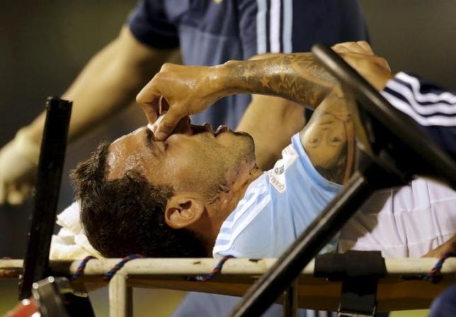 Argentina's Carlos Tevez is carried on stretcher off the field during the 2018 World Cup qualifying soccer match against Paraguay at the Defensores del Chaco stadium in Asuncion, Paraguay, October 13, 2015. REUTERS/Mario Valdez