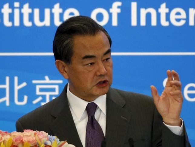 Chinese Foreign Minister Wang Yi delivers a speech during the international seminar commemorating the 10th anniversary of the September 19 joint statement of six-party talks at the Diaoyutai State Guesthouse in Beijing, China, September 19, 2015.  REUTERS/Kim Kyung-Hoon/Files