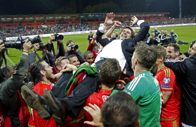 Wales coach Chris Coleman celebrates with players after their Euro 2016 qualifying soccer match against Bosnia in Zenica October 10, 2015. REUTERS/Dado Ruvic