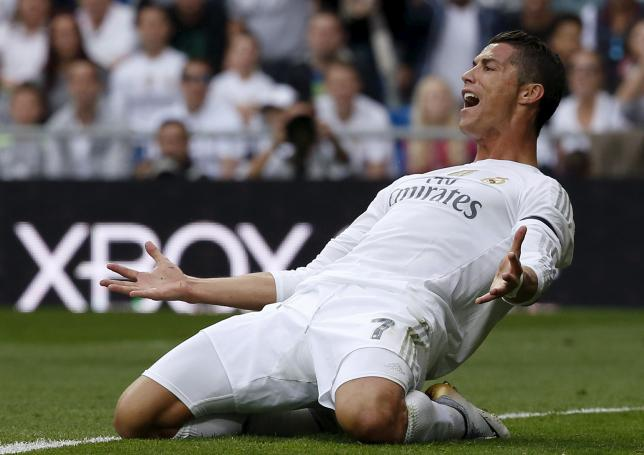 Real Madrid's striker Cristiano Ronaldo reacts during their Spanish First Division soccer match against Levante at Santiago Bernabeu stadium in Madrid, October 17, 2015. REUTERS/Juan Medina