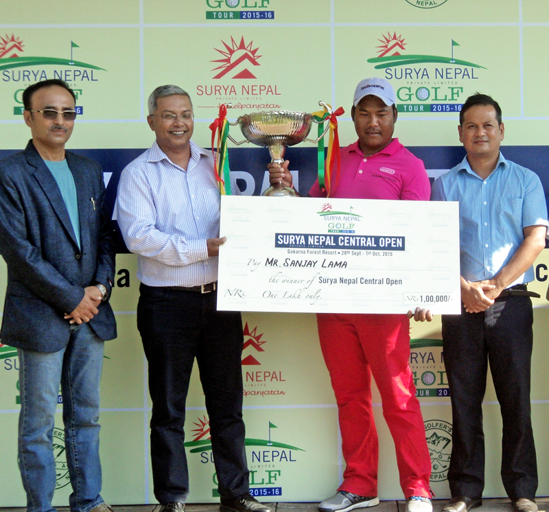 Sanjay Lama (second from right) receives the Surya Nepal Central Open trophy from Dipra Lahiri, Vice-president, Sales and Marketing at Surya Nepal as NPGA President RM Shrestha (left) and Surya Nepal Brand Manager Keshav Pradhan look on, in Kathmandu on Thursday, October 01, 2015. Courtesy: NPGA
