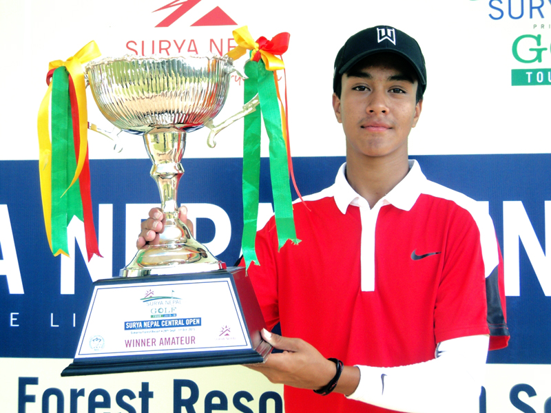 Prithivi Malla holds the amateur trophy after the Surya Nepal Central Open at the Gokarna Golf Club in Kathmandu on Thursday. Courtesy: NPGA
