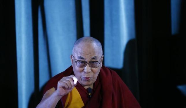Tibetan spiritual leader, the Dalai Lama speaks during a news conference at Magdalene College in Oxford, Britain September 14, 2015.   REUTERS/Darren Staples/Files
