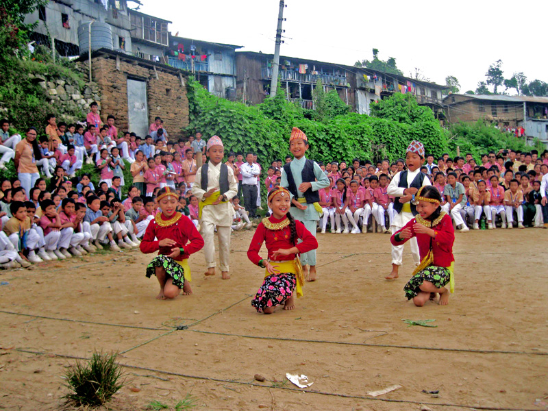 Children perform a dance during a traffic rules and gender discrimination awareness programme, organised by the Community Service Centre, at the premises of Everest Boarding School in Diktel of Khotang district, on Friday, October 02, 2015. Photo: Dilip Khatri