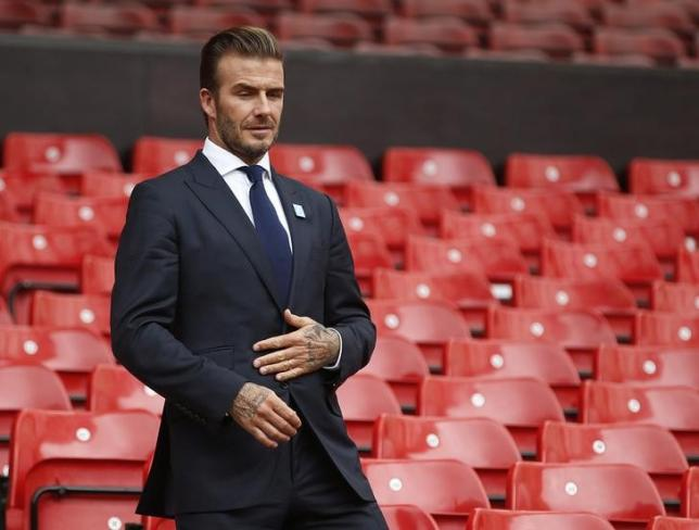 David Beckham arrives for a photocall at Old Trafford, ahead of his upcoming charity soccer match against a Rest of the World team led by Zinedine Zidane at Old Trafford to raise awareness and funds for UNICEF, in Manchester, Britain, October 6, 2015. REUTERS/ Andrew Yates