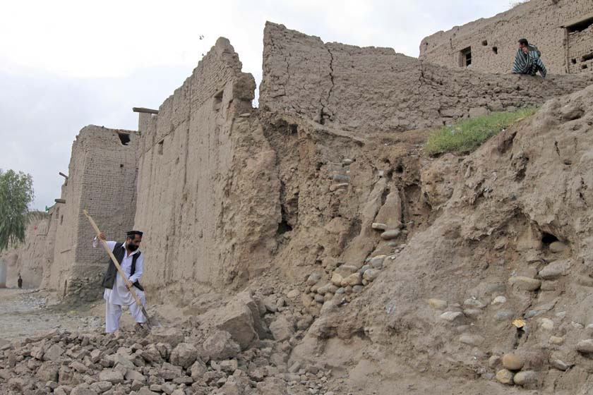 A man clears rubble after part of his house collapsed during an earthquake, at a hospital in Jalalabad, Afghanistan October 26, 2015. A powerful earthquake struck a remote area of northeastern Afghanistan on Monday, shaking the capital Kabul, as shock waves were felt in northern India and in Pakistan's capital, where hundreds of people ran out of buildings as the ground rolled beneath them. REUTERS