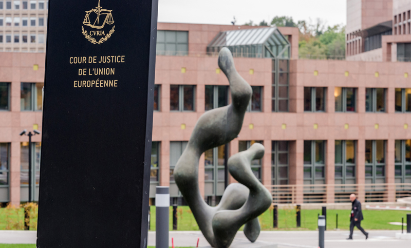 In this photo taken on Monday, Oct. 5, 2015 a man walks by the European Court of Justice in Luxembourg. The European Unionu0092s highest court has ruled that a member state can ban prisoners guilty of serious offenses from voting in EU elections in a decision which was hotly awaited in Britain. (Geert Vanden Wijngaert)
