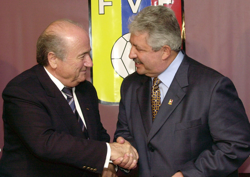 FILE - In this Nov. 8, 2004 file photo Sepp Blatter, President of the FIFA, left, shakes hands with the President of the Venezuelan Soccer Federation, Rafael Esquivel, in Caracas, Venezuela. Switzerlandu0092s justice ministry granted a U.S. request to extradite Venezuelan football official Rafael Esquivel in a FIFA bribery investigation. Esquivel is u0093accused of receiving bribes worth millions of dollars in connection with the sale of marketing rights to the Copa America tournaments in 2007, 2015, 2016, 2019 and 2023,u0094 the Swiss ministry said in a statement on Wednesday, Sept. 23, 2015.  (AP Photo/Leslie Mazoch)