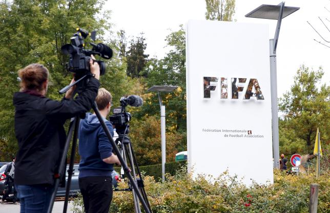 Members of the media film the FIFA logo outside their headquarters in Zurich October 8, 2015.  REUTERS/Arnd Wiegmann