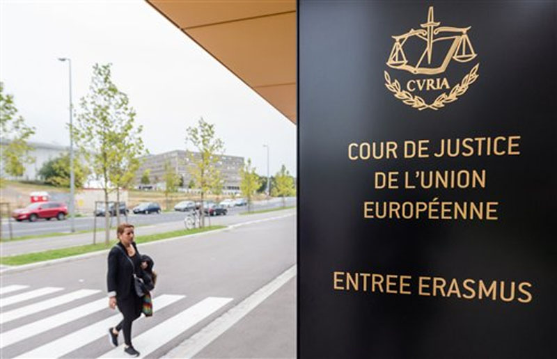 A woman walks by the entrance to the European Court of Justice in Luxembourg on Monday, October 5, 2015. Photo: AP