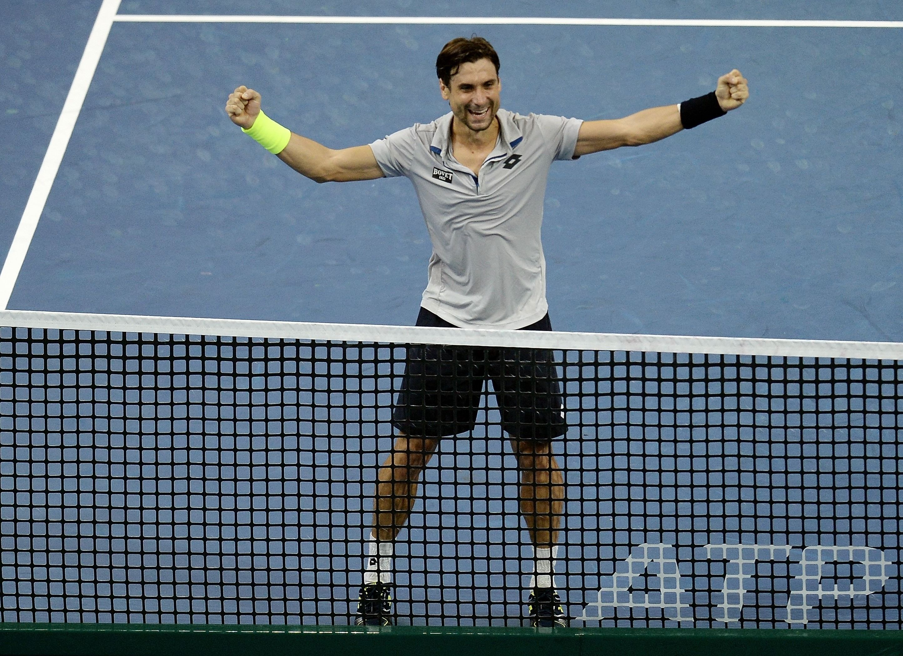 Spain's David Ferrer celebrates after defeating compatriot Feliciano Lopez during the men's singles final at the 2015 Malaysian Open tennis tournament in Kuala Lumpur on October 4, 2015.   AFP PHOTO / MANAN VATSYAYANA