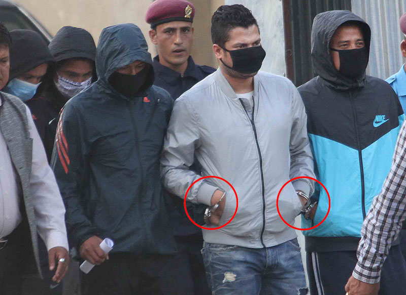 Five football players, masked and handcuffed, brought out of the Metropolitan Police Crime Division office after their arrest for match-fixing, in Teku of Kathmandu on Thursday, October 15, 2015. Photo: Udipt Singh Chhetry