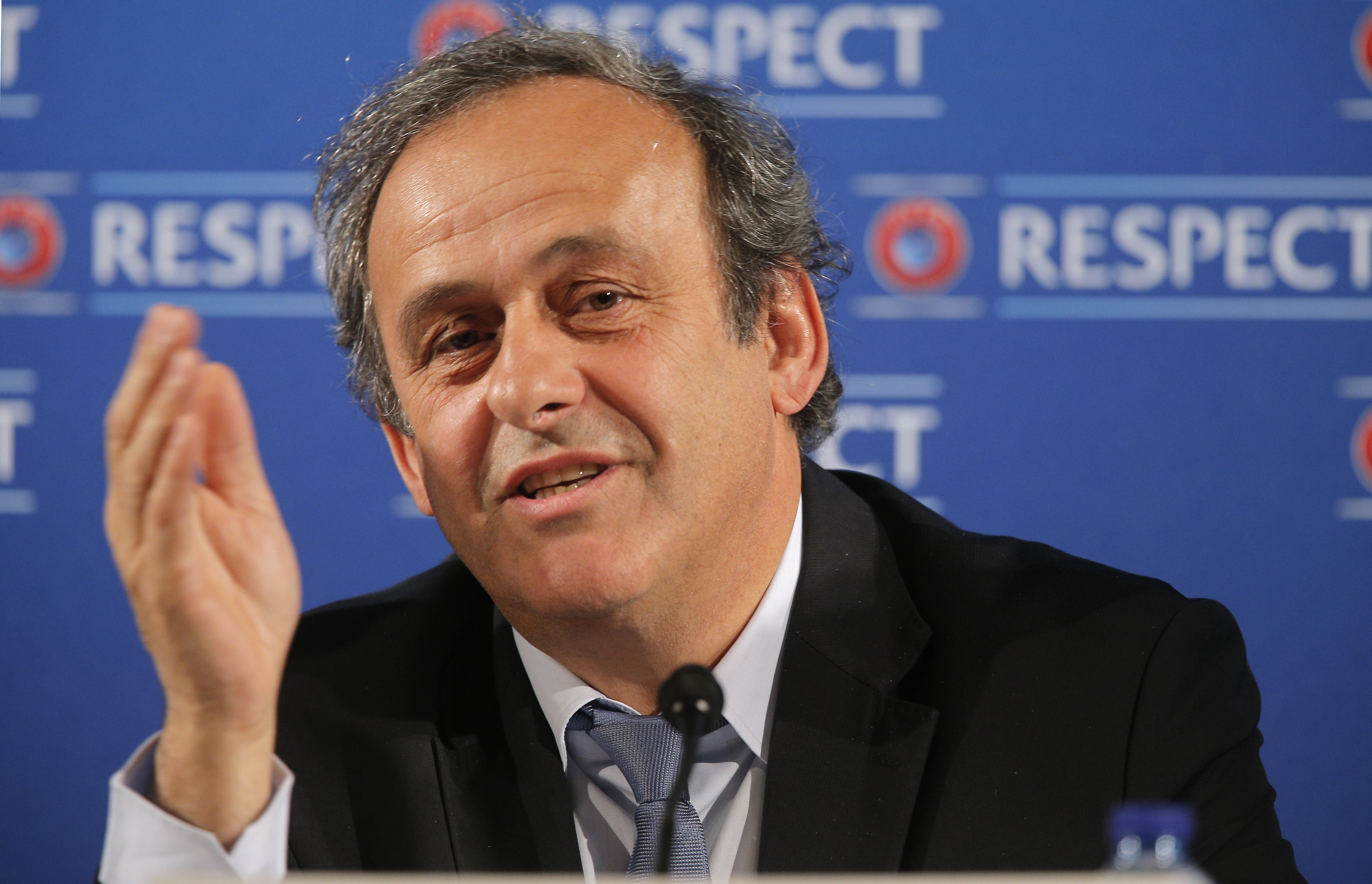 FILE - In this file photo dated Saturday, Feb 22, 2014, UEFA President Michel Platini gestures during a press conference, one day prior to the UEFA EURO 2016 qualifying draw at the Acropolis Convention Centre in Nice, southeastern France. Seven men are in the running to replace Sepp Blatter as FIFA president, with Michel Platiniu0092s candidature pending because of his suspension from soccer.   (AP Photo/Lionel Cironneau, FILE)