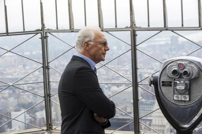 Football legend Franz Beckenbauer pauses to look out on the city on top of the Empire State Building during an event to celebrate the start of the New York Cosmos 2015 season, in New York April 17, 2015. REUTERS/Lucas Jackson