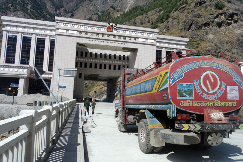 A tanker of the Nepal Oil Corporation (NOC) enters Kyirong via Rasuwagadhi border point to receive the petrol provided as a grant by the Government of China in Rasuwa on Saturday, October 31, 2015. Photo: RSS