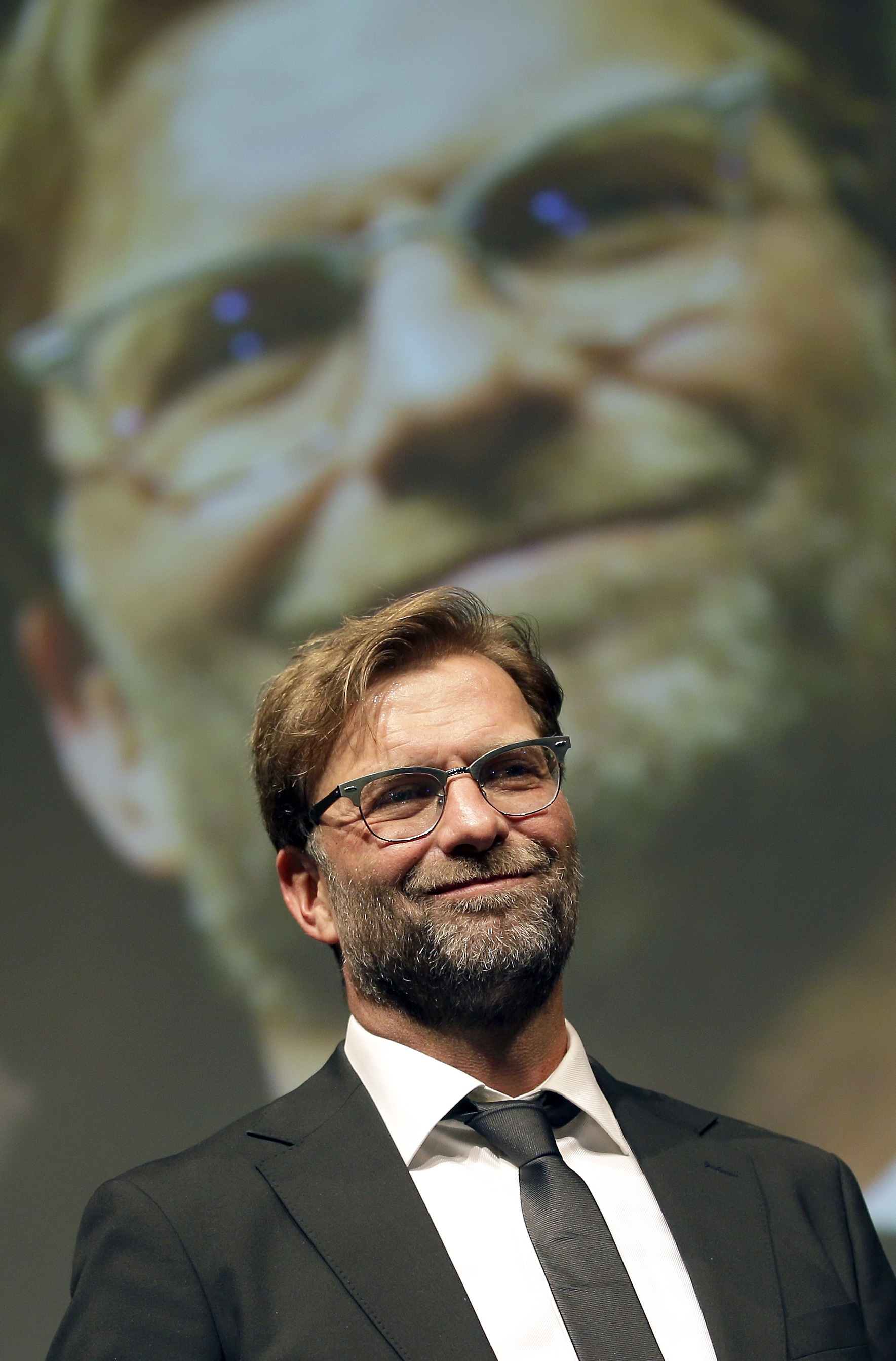 FILE - In this May 31, 2015 file photo Dortmund's head coach Juergen Klopp smiles during his fare well speech as part of a reception in Berlin, Germany, after the German soccer cup final match between Borussia Dortmund and VfL Wolfsburg.  (AP Photo/Michael Sohn,Pool)