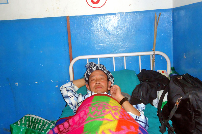 Hem Yonghang, injured after being beaten for failing to gift a buffalo, undergoing treatment at the Panchthar District Hospital in Phidim on Sunday, October 25, 2015. Photo: Laxmi Gautam/ THT