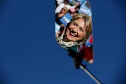 Democratic presidential candidate Hillary Clinton is reflected in a glass teleprompter as she holds a rally with grassroots supporters in Alexandria, Virginia, October 23, 2015. REUTERS/Jonathan Ernst