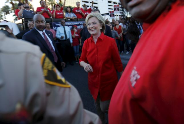 Democratic U.S. presidential candidate and former Secretary of State Hillary Clinton greets members of the culinary workers union local 226 after speaking at a demonstration outside the Trump Hotel in Las Vegas, Nevada October 12, 2015. REUTERS/Mike Blake