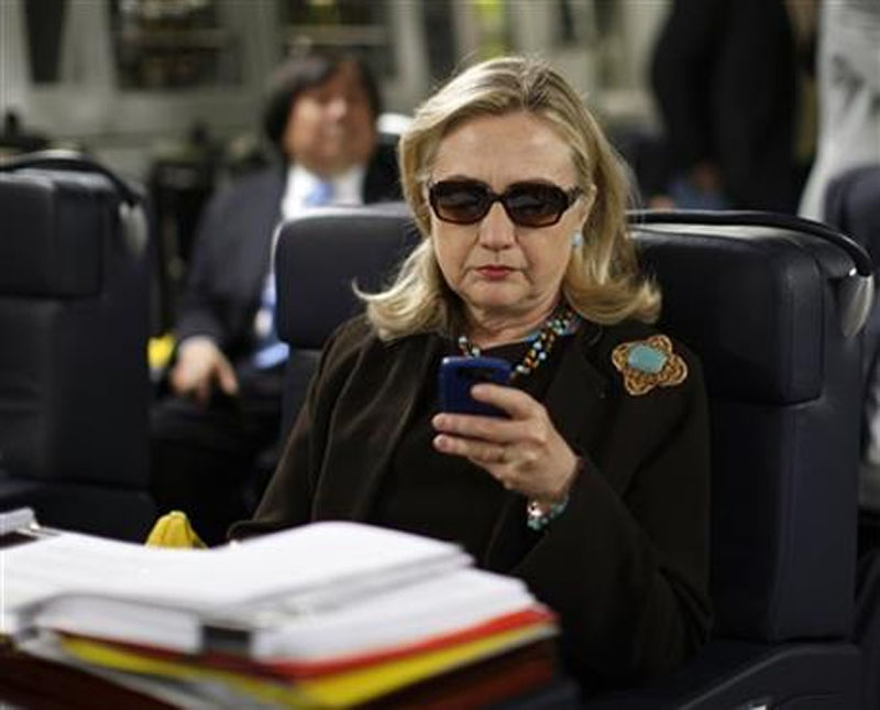 Secretary of State Hillary Rodham Clinton checking her email, on October 18 2011. Photo: AP