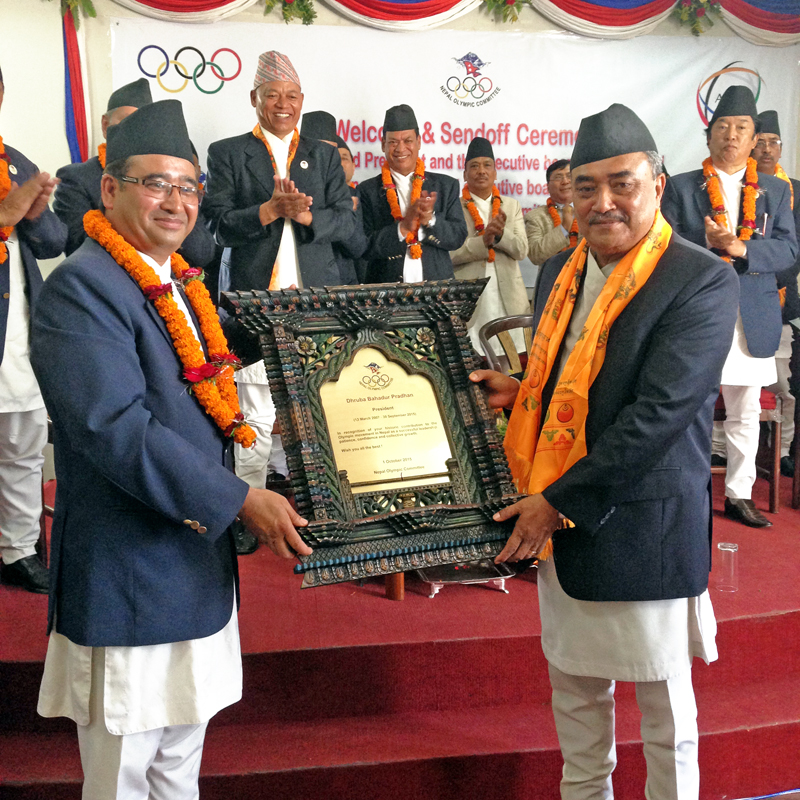 President of Nepal Olympic Committee Jeevan Ram Shrestha (left) handing over the letter of appreciation to the outgoing president Dhruba Bahadur Pradhan at a programme in Lalitpur on Thursday. Photo: THT