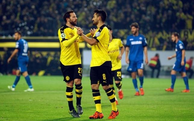 Borussia Dortmund's Ilkay Guendogan (R) and Gonzalo Castro celebrate a goal against SC Paderborn during their German Cup (DFB Pokal) second round soccer match in Dortmund, Germany, October 28, 2015.  REUTERS/Ina Fassbender