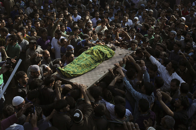 Kashmiri Muslim villagers carry the body   of a suspected rebel, during his funeral procession at Barhama, 40 kilometers (25 miles) south of Srinagar, Indian controlled Kashmir, Monday, Oct. 5, 2015. At least four Indian army soldiers and three suspected rebels were killed in three separated gun battles in Indian-controlled Kashmir, police said on Monday. (AP Photo/Mukhtar Khan)