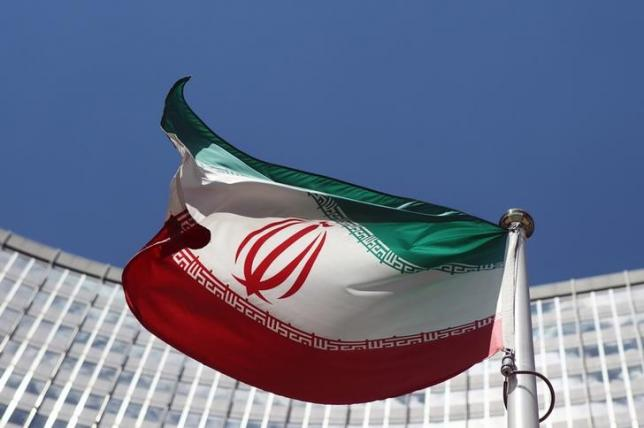 An Iranian flag flutters in front of the United Nations headquarters in Vienna June 17, 2014. REUTERS/Heinz-Peter Bader/Files