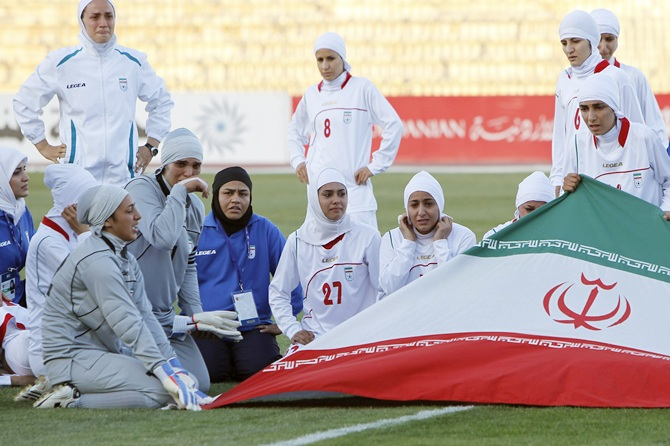 File- The Iranian women's national soccer team react after withdrawing from their qualifying match against Jordan for the 2012 London Olympic Games in Amman June 3, 2011. The Iranian team were banned from the match on Friday in the second round of qualifiers in protest against guidelines on their veil. The FIFA woman's association requires that any covering used does not cover the neck and ears. In Iran all women are required to cover their hair in public to conform to the Islamic dress code.  Photo: Reuters