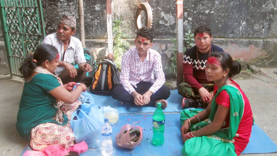 Jailbirds enjoying the delicacies after receiving Dashain Tika from their relatives on the premises of Tanahun Prison in Tanahun district. Photo Caption: Madan Wagle