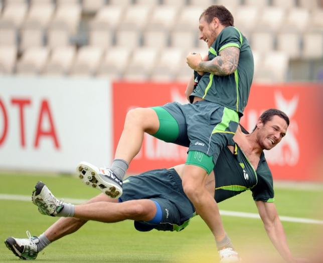 Australia's James Pattinson (top) and Nathan Coulter-Nile rip each others shirts during a training sessionnAction Images via Reuters / Philip BrownnLivepic