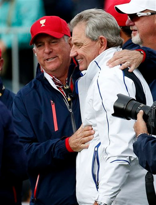 Rival captain's Jay Haas, left, of the US and Nick Price embrace after the United States team defeated the International team 15 1/2 to 14 1/2 to retain the Presidents Cup at the Jack Nicklaus Golf Club Korea, in Incheon, South Korea on Sunday, October 11, 2015. Photo: AP