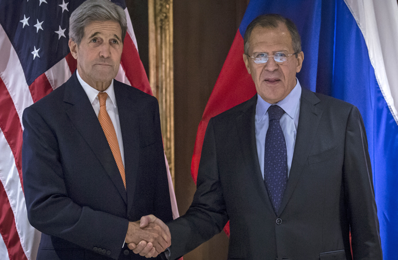 U.S. Secretary of State John Kerry, left, and Russian Foreign Minister Sergey Lavrov, shake hands during a photo opportunity but without speaking to reporters, in Vienna, Austria, Friday Oct. 23, 2015. Photo: AP