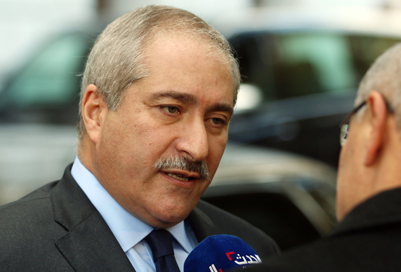 Jordanian Foreign Minister Nasser Judeh talkjs to journalists in front of a hotel after meetings in Vienna, Austria, Friday, Oct. 23, 2015. Photo: AP
