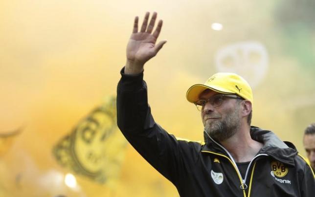 Borussia Dortmund coach Juergen Klopp arrives prior to their German Cup (DFB Pokal) final soccer match against VfL Wolfsburg in Berlin, Germany, May 30, 2015. REUTERS/Ralph Orlowski