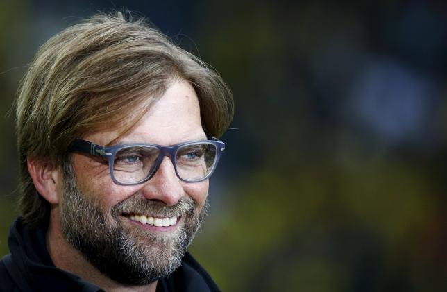 Juergen Klopp, then coach of Borussia Dortmund, smiles before their German Cup (DFB Pokal) final soccer match against Bayern Munich in Berlin, in this May 17, 2014 file picture. REUTERS/Michael Dalder/Files