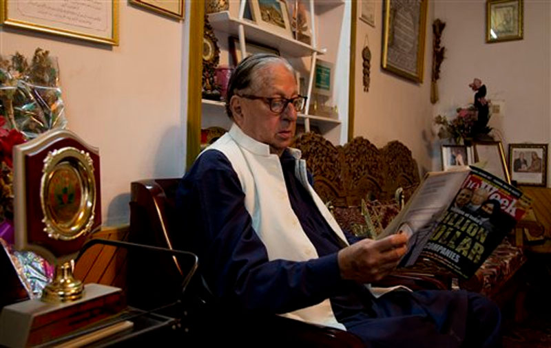 Kashmiri writer and senior Journalist Ghulam Nabi Khayal reads a magazine at his residence on the outskirts of Srinagar, Indian controlled Kashmir, on Wednesday, October 14, 2015. Photo: AP