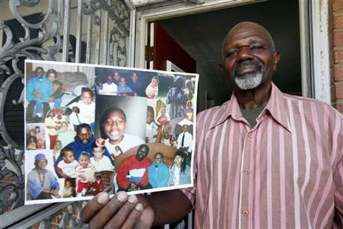 Kenneth Evans holds a composite of photographs of his son Tuan Evans, as he poses for a photograph at his home in Temple Hills, Md. Drug criminals once described by prosecutors as unrepentant repeat offenders are among those poised to benefit from new sentencing guidelines that are shrinking punishments for thousands of federal prisoners on September 16, 2015. Photo: AP