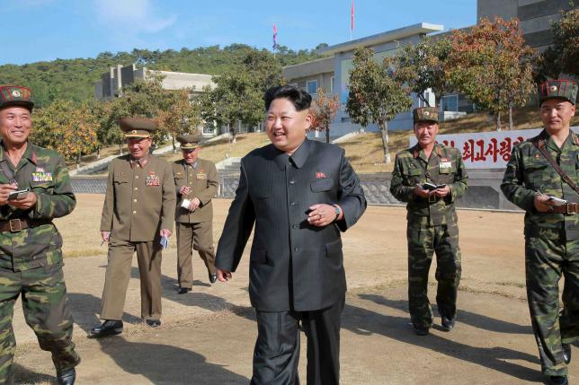North Korean leader Kim Jong Un walks during an inspection of the Korean People's Army (KPA) Unit 350, in this undated photo released by North Korea's Korean Central News Agency (KCNA) in Pyongyang on October 16, 2015. REUTERS/KCNA