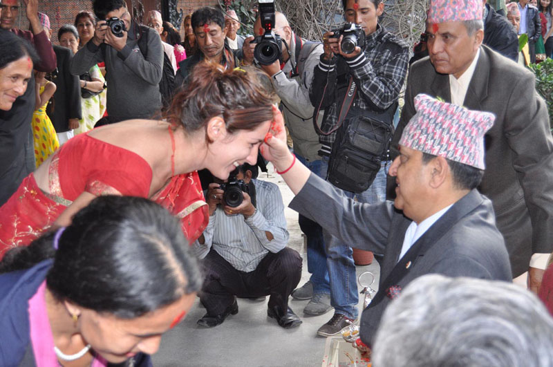 Former King Gyanendra Shah offers Dashain Tika to a woman in an undated file photo. Photo: THT