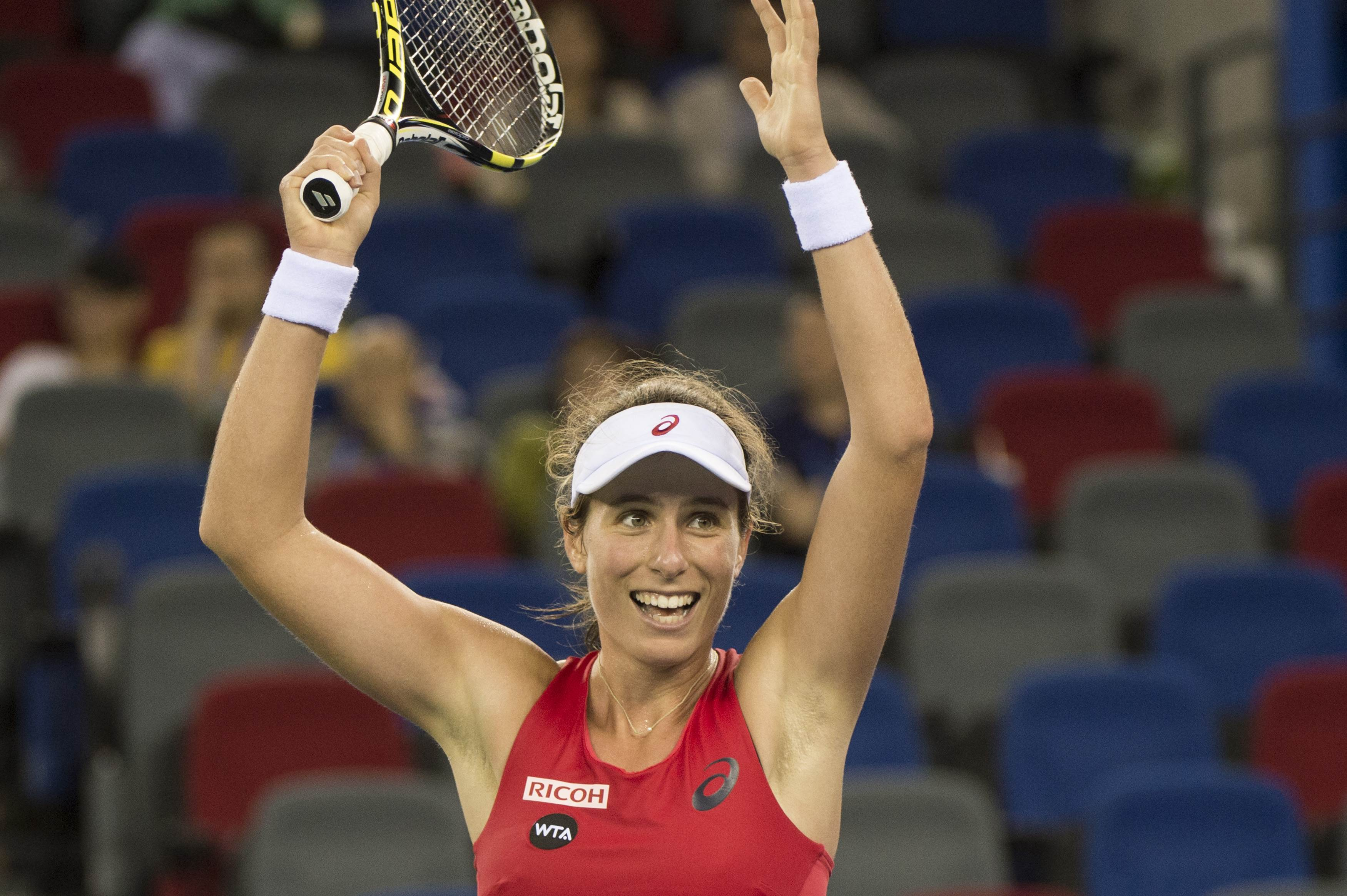 Johanna Konta of Great Britain reacts after she defeats Simona Halep of Romania during the women's singles match on day three of the Wuhan Open tennis tournament in Wuhan, in China's Hubei province on September 30, 2015. AFP PHOTO / FRED DUFOUR